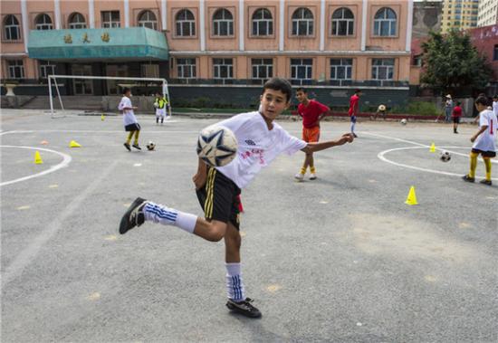 Tianjin helping Xinjiang's football development in China