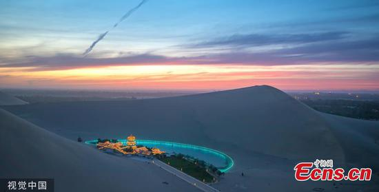Dunhuang city in Northwest China's Gansu province, is brightened by stars when the nights falls in May, 2019. (Photo/VCG)