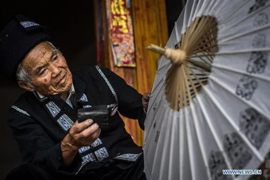 Inheritors of traditional oil-paper umbrella making in Xiangyang Village