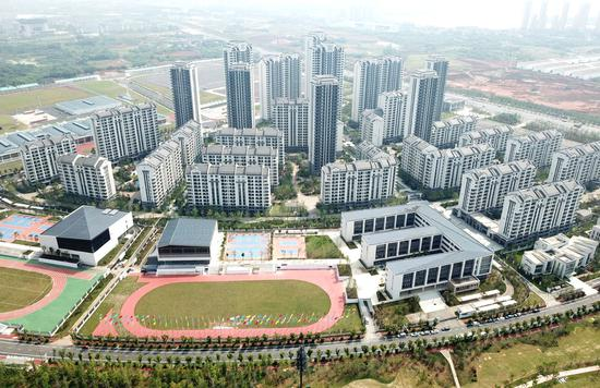 This aerial photo taken on July 10, 2019, shows the Military World Games Village in Jiangxia district of Wuhan, Central China's Hubei province. (Photo/Xinhua)
