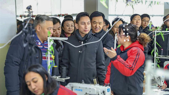 Diplomats from 12 countries visited a vocational center in Xinjiang, December 28-30, 2018. (Photo/Xinhua)