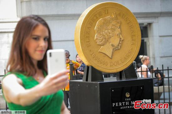 Gigantic gold coin makes its way to Wall Street