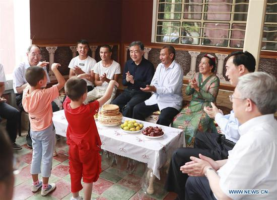 Wang Yang, a member of the Standing Committee of the Political Bureau of the Communist Party of China (CPC) Central Committee, who is also in charge of coordinating the CPC Central Committee's work on Xinjiang, visits a village in Hotan, northwest China's Xinjiang Uygur Autonomous Region, July 15, 2019.  (Photo: Xinhua/ Ding Lin)
