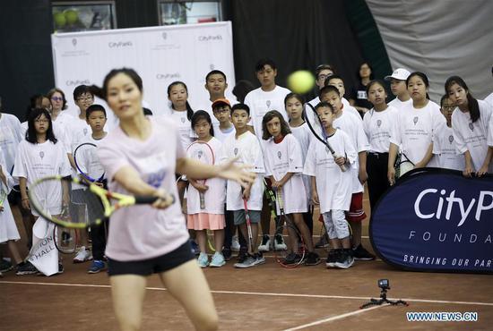 China's Li Na devotes herself to next generation of tennis players