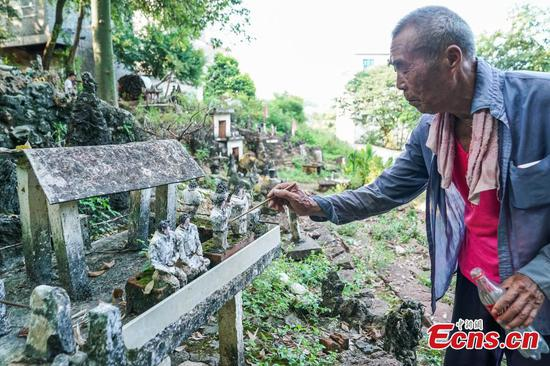 83-year-old creates impressive cement figurine collection in village