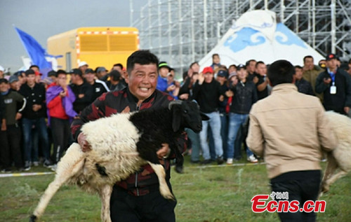 Race while carrying sheep in Xinjiang festival
