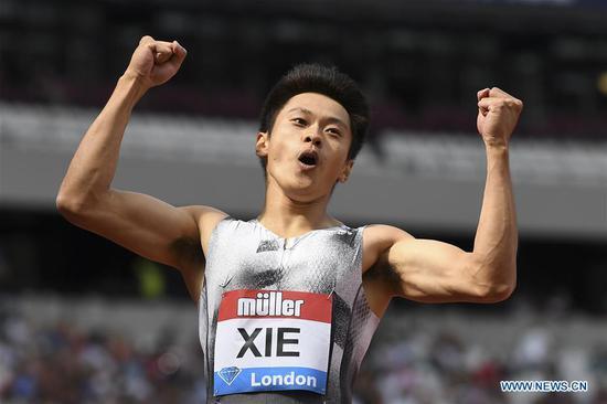 谢振业在伦敦打破亚洲男子200m纪录,谢文俊获得1.1亿跨栏冠军