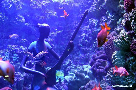Statues installed underwater in aquariums at ocean park in Qingdao