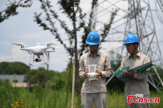 Drone and robot used to ensure power supply in summer