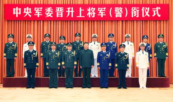 Xi Jinping (C, front), chairman of the Central Military Commission (CMC), and other leaders pose for a group photo with ten senior Chinese military and armed police officers who have been promoted to the rank of general in Beijing, capital of China, July 31, 2019. Xi presented the officers with certificates of order signed by him at a ceremony the CMC held in Beijing on Wednesday. (Xinhua/Li Gang)