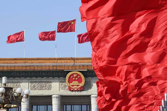 Photos taken on March 5, 2019 shows the Great Hall of the People with red flags atop. (Xinhua/Yang Zongyou)