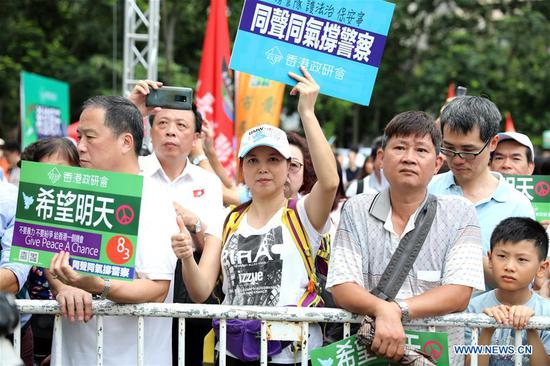 90,000 rally in support of HK police, seek end to violence