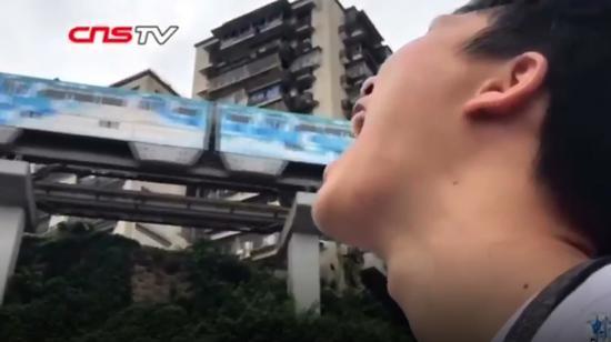 Light rail train driving through residential building becomes tourist destination