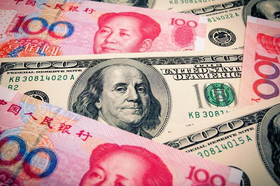 Central bank head says yuan rate 'broadly stable'