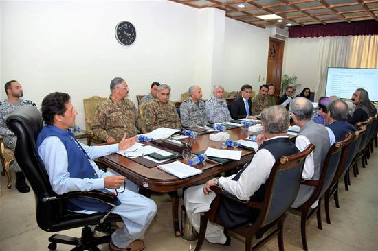 Photo released by Prime Minister Office on Aug. 7, 2019 shows Pakistan's Prime Minister Imran Khan (front L) chairs a National Security Committee meeting along with armed forces chiefs and other government officials in Islamabad, capital of Pakistan. Pakistan on Wednesday decided to suspend bilateral trade and downgrade its diplomatic relations with India in a meeting of the National Security Committee chaired by Prime Minister Imran Khan, the Prime Minister Office said in a statement. (Prime Minister Office/Handout via Xinhua)