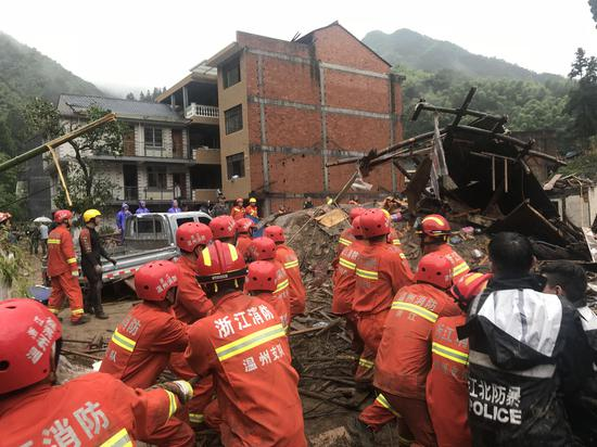 Rescuers work at typhoon damaged area in Yongjia County, east China's Zhejiang Province, Aug. 10, 2019. (Xinhua)