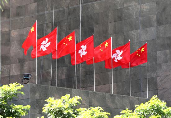 The Chinese national flags and flags of the Hong Kong SAR flutter in Hong Kong. (Photo/Xinhua)