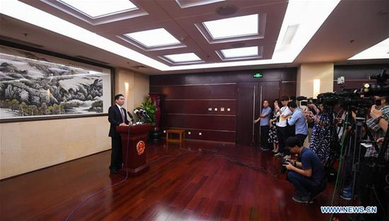 Yang Guang (L), spokesperson for the Hong Kong and Macao Affairs Office of the State Council, remarks on Hong Kong rioters' petrol bomb attacks on police in Beijing, Aug. 12, 2019. Yang on Monday strongly condemned the acts of a very small number of rioters in Hong Kong who on Sunday hurled petrol bombs at the police, causing injuries.