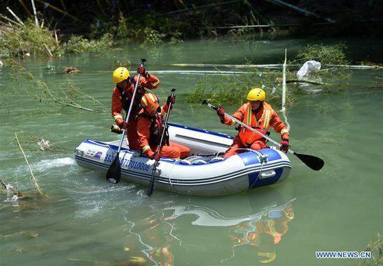 Rescuers work at the landslide site in Shanzao Village of Yantan Township in Yongjia County, east China's Zhejiang Province, Aug. 12, 2019. By Monday morning, the death toll in Zhejiang Province has risen to 39 while nine others remained missing, said the Zhejiang provincial flood control headquarters. Typhoon Lekima, the ninth and strongest typhoon of the year, landed around 1:45 a.m. Saturday in the city of Wenling in Zhejiang Province. (Xinhua/Han Chuanhao)