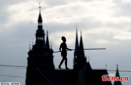 Tightrope walker Tatiana-Mosio Bongonga performs on a rope above the Vltava river