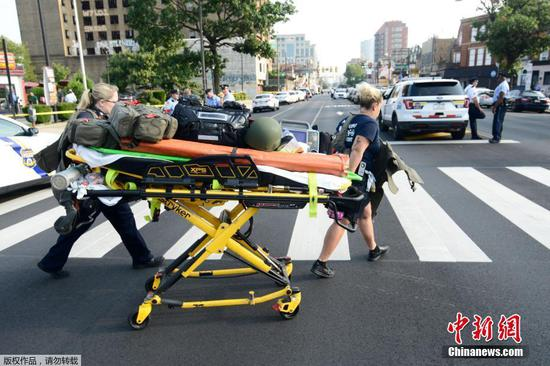 Paramedics roll a stretcher near the scene of a shooting incident in which several police were injured in Philadelphia, Pennsylvania, U.S. Aug. 14, 2019. (Photo/Agencies)