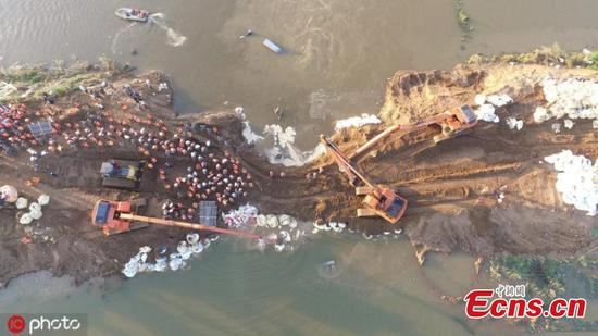 River breach in China's vegetable basket blocked
