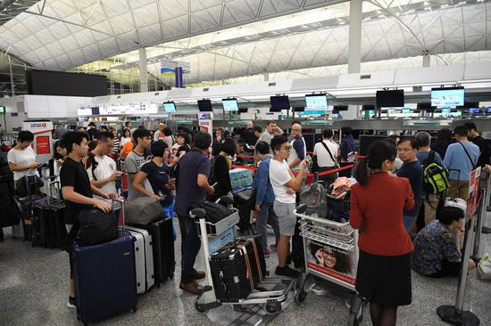 Int'l travelers welcome restored order at Hong Kong airport