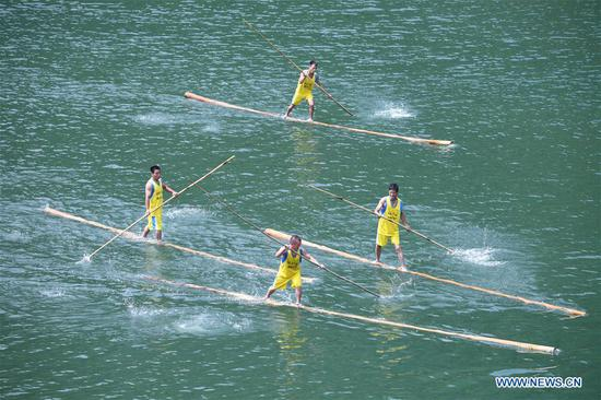 Villagers perform single bamboo drifting in Fujian