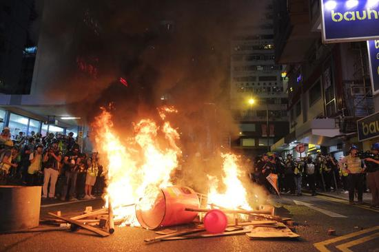 Violent radicals set fires after blocking a road in Causeway Bay, south China's Hong Kong, Aug. 4, 2019. (Photo/Xinhua)