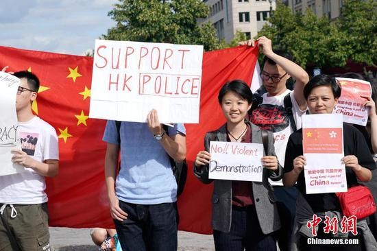 Thousands of overseas Chinese, students in London chorus 'Save Hong Kong' from violence