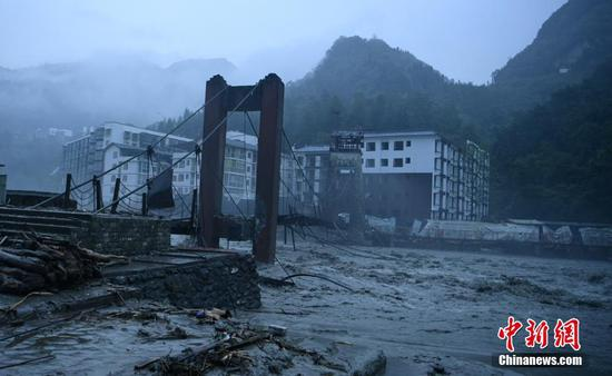 A suspending bridge is damaged by rain-triggered mudslides in Wenchuan, Sichuan Province, Aug. 20, 2019. (Photo/China News Service)