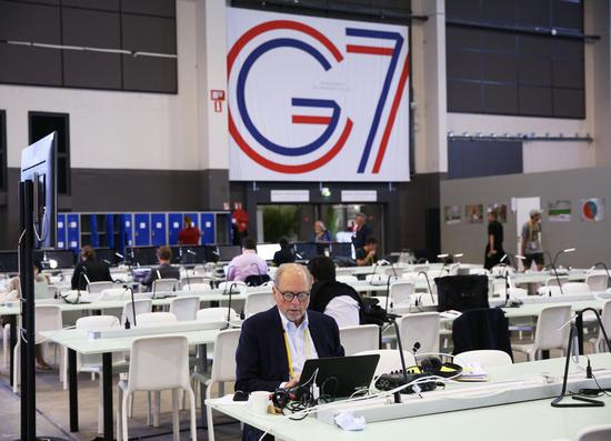Journalists work at the G7 summit press center in Biarritz, southwestern France, Aug. 23, 2019. (Xinhua/Gao Jing)