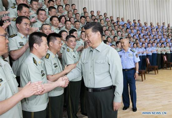 Chinese President Xi Jinping, also general secretary of the Communist Party of China Central Committee and chairman of the Central Military Commission, inspects an air force base in northwest China's Gansu Province, Aug. 22. 2019. (Xinhua/Li Gang)