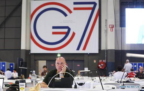 Journalists work at the G7 summit press center in Biarritz, France, Aug. 25, 2019. Leaders from the world's seven most industrialized countries started the divided group's 45th summit, clouded by a pile of tough issues with trade tensions high on agenda, on Saturday evening at the French seaside resort Biarritz. (Xinhua/Gao Jing)