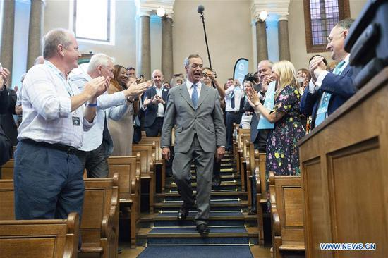 Brexit Party leader Nigel Farage (C) arrives to make a speech in London, Britain, on Aug. 27, 2019. Nigel Farage said the newly formed Brexit Party plans to contest all 650 parliamentary seats in a general election. Farage, who co-founded the anti-EU UKIP party, said the new Brexit party would be prepared to form a non-aggression pact with the Conservatives if Prime Minister Johnson pursues a no-deal Brexit. (Photo by Ray Tang/Xinhua)