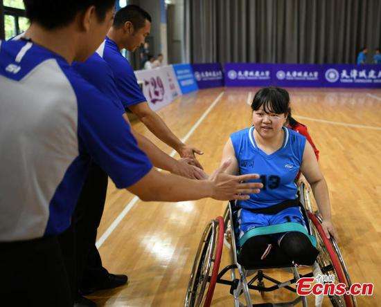 Quake survivor now youngest in Sichuan women's wheelchair basketball team