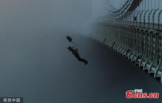 Incredible moment base jumper dives from iconic UK bridge