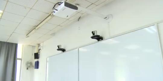 Electronic monitors are installed in a classroom in China Pharmaceutical University. (Photo/www.thepaper.cn)
