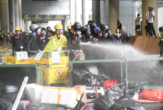 Radical protesters build barricades at Hong Kong International Airport in south China's Hong Kong, Sept. 1, 2019. (Xinhua)