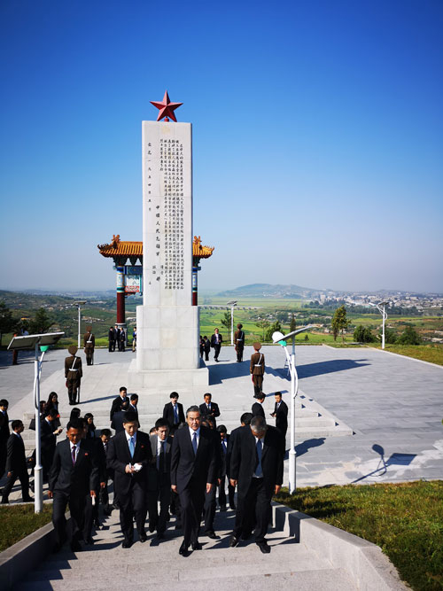 Visiting Chinese State Councillor and Foreign Minister Wang Yi, along with the Chinese delegation, visits the Martyrs Cemetery of the Chinese People's Volunteers in Hoechang County, South Phyongan Province, DPRK. /Chinese Foreign Ministry Photo