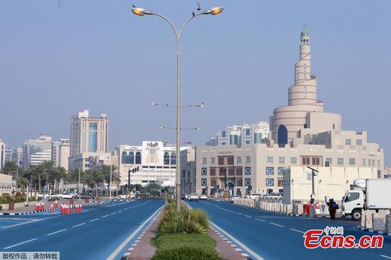 Road turns blue in Doha to cool down temperature