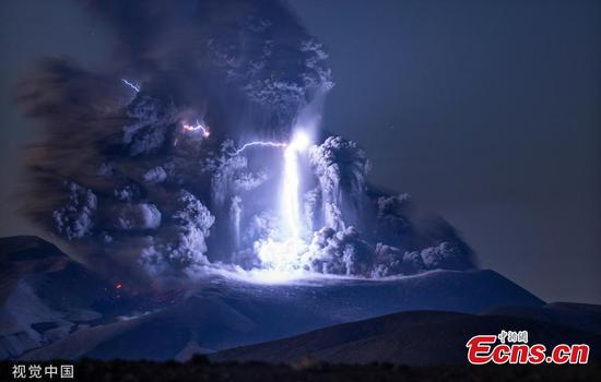 Lightning strikes at centre of erupting volcano