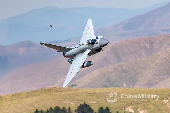 J-10 fighter jet flies through the valley