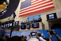 U.S. stocks close higher amid trade hopes, data