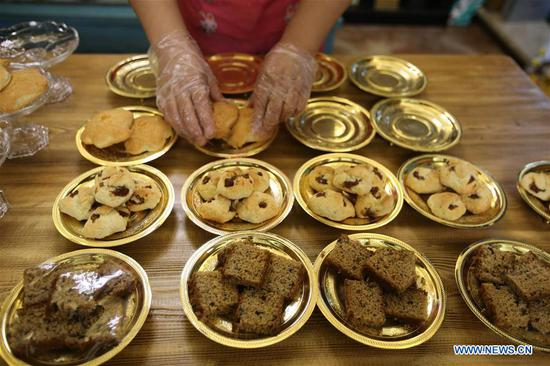 Tourists taste foods of various ethinic minorities in Tacheng, Xinjiang