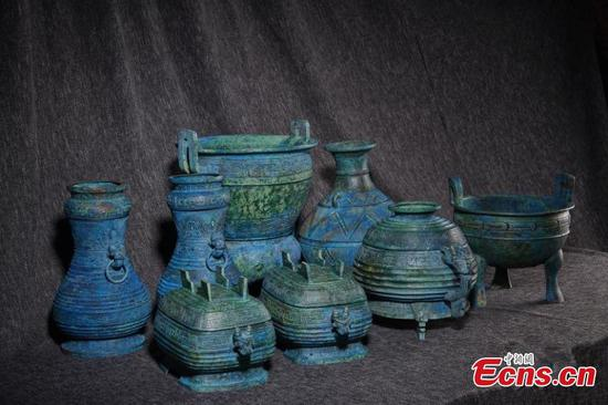 Elaborate bronze ware set retrieved from Japan
