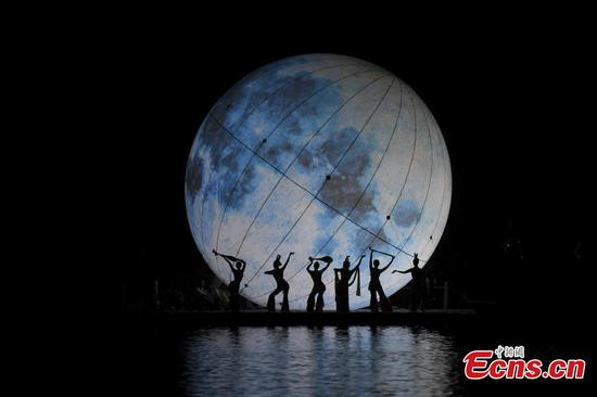 Moonlight dance ahead of Mid-Autumn Festival