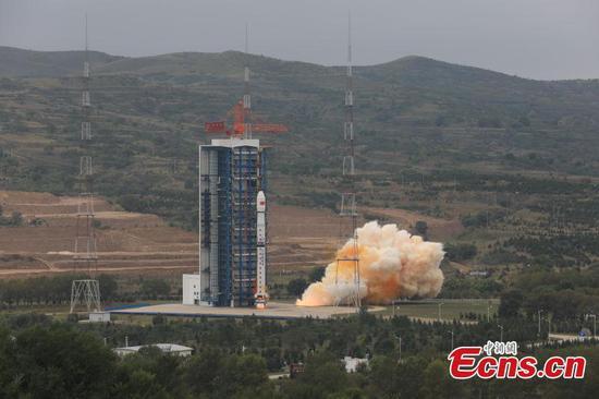 China launches three new satellites