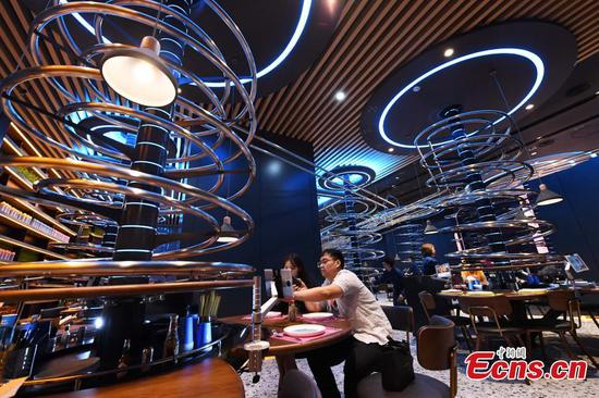 Rollercoaster tracks deliver food to diners in Chongqing restaurant