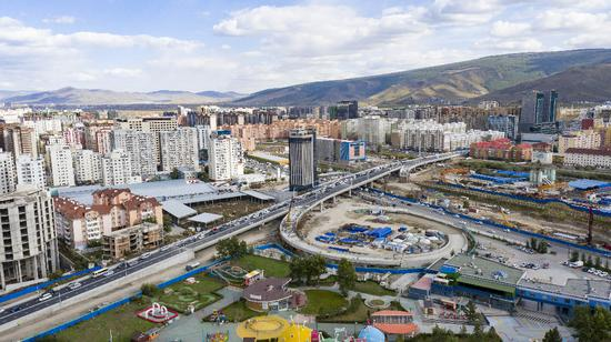 A 1,100-meter China-funded overpass in Mongolia opens to traffic.